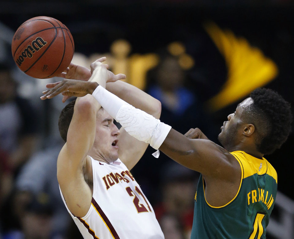 Photo - Baylor guard Gary Franklin, right, knocks the ball away from Iowa State guard Matt Thomas (21) during the first half of an NCAA college basketball game in the final of the Big 12 Conference men's tournament in Kansas City, Mo., Saturday, March 15, 2014. (AP Photo/Orlin Wagner)