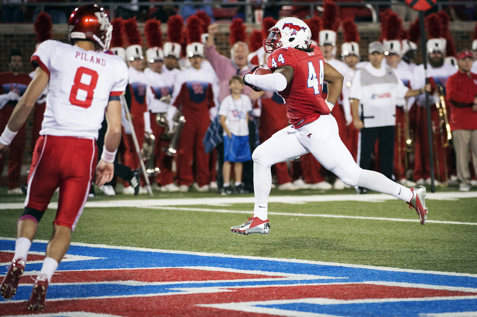 Photo -   SMU linebacker Taylor Reed (44) runs into the end zone for a touchdown after intercepting a pass by Houston quarterback David Piland (8) during the second quarter of an NCAA college football game, Thursday, Oct. 18, 2012, in Dallas. (AP Photo/Houston Chronicle, Smiley N. Pool) MANDATORY CREDIT