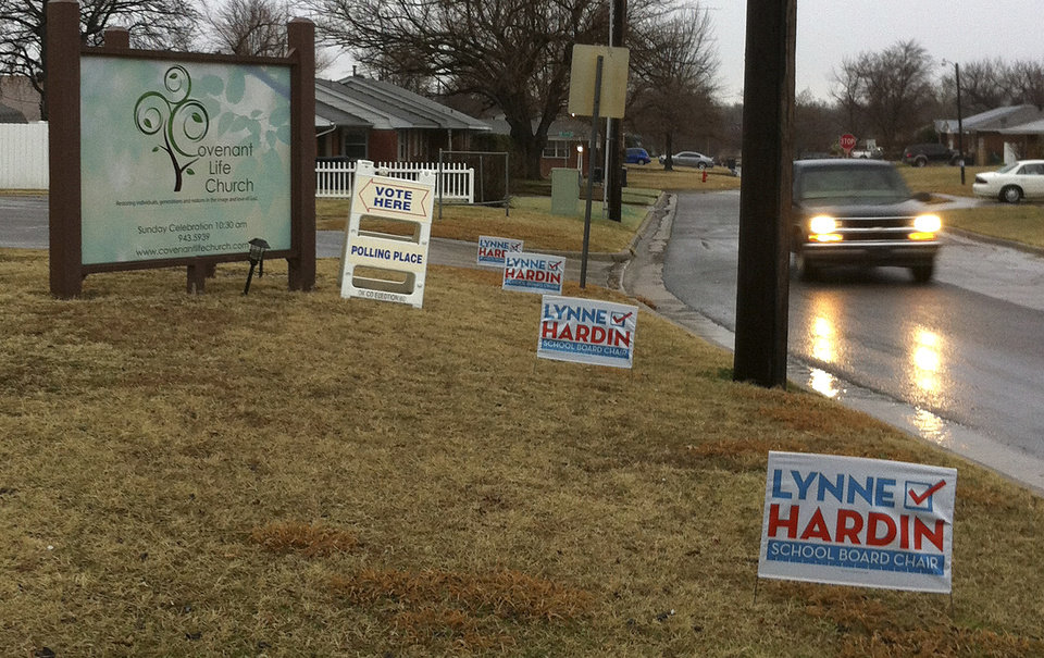 Photo - campaign signs for Oklahoma City School Board chairwoman candidate Lynne Hardin are posted outside a polling place Tuesday morning in northwest Oklahoma City. Poll workers said they were waiting for supervisors to remove the signs. THE OKLAHOMAN