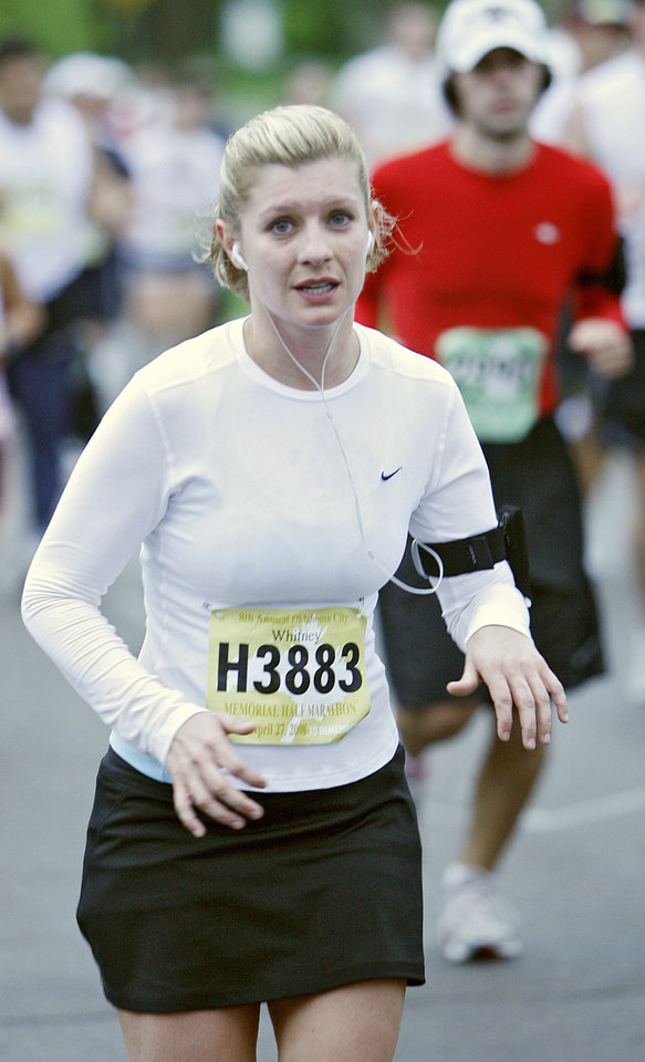 Photo - Marathon runner Whitney Waller runs during the eighth annual Oklahoma City Memorial Marathon on Sunday , April 27, 2008, in Oklahoma City, Okla.   PHOTO BY CHRIS LANDSBERGER   ORG XMIT: KOD