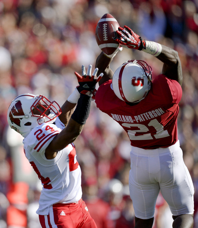Stanford wide receiver Jamal-Rashad Patterson (21) makes a catch against Wisconsin defensive back Shelton Johnson (24) during the first half of the Rose Bowl NCAA college football game, Tuesday, Jan. 1, 2013, in Pasadena, Calif. (AP Photo/Mark J. Terrill)