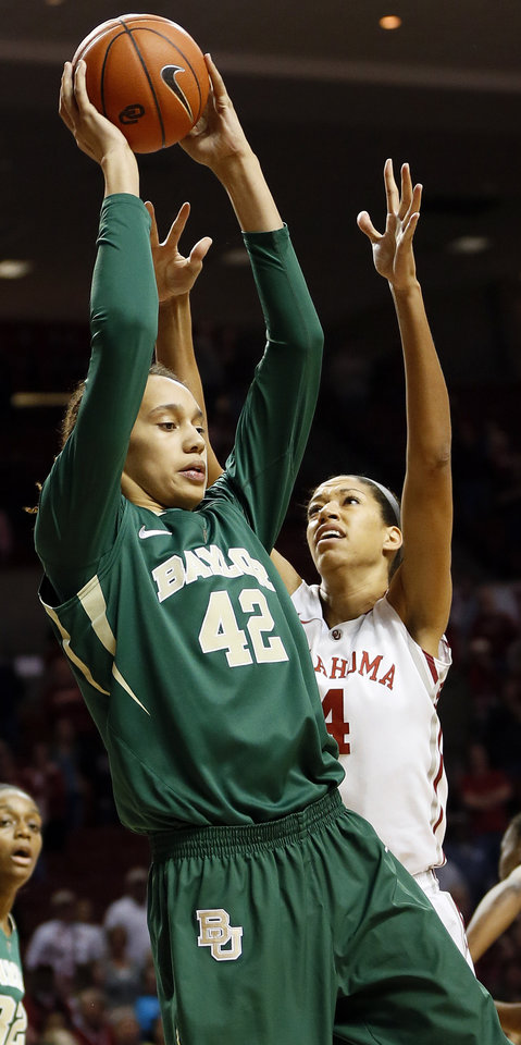 Baylor's Brittney Griner (42) grabs a rebound against Oklahoma's Nicole Griffin (4) during a women's college basketball game between the University of Oklahoma (OU) and Baylor at the Lloyd Noble Center in Norman, Okla., Monday, Feb. 25, 2013. Photo by Nate Billings, The Oklahoman