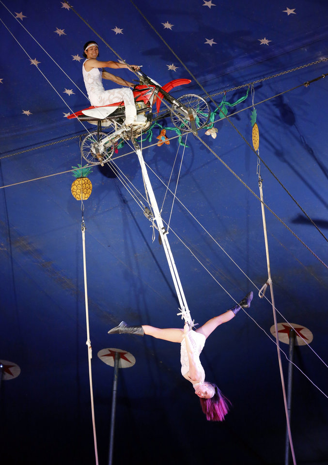 Photo -  Stuntman Fridman Torales performs with an aerialist in Pauls Valley. [PHOTO BY STEVE SISNEY, THE OKLAHOMAN]