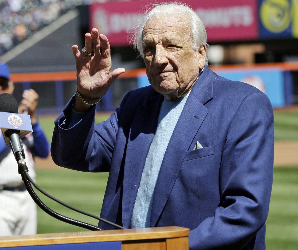 Photo - FILE - In this April 5, 2012 file photo, Hall of Famer Ralph Kiner waves to the crowd before announcing the New York Mets starting line-up before an opening day baseball game against the Atlanta Braves at Citi Field in New York. The baseball Hall of Fame says slugger Ralph Kiner has died. He was 91. The Hall says Kiner died Thursday, Feb. 6, 2014, at his home in Rancho Mirage, Calif.WLD (AP Photo/Frank Franklin II, File)