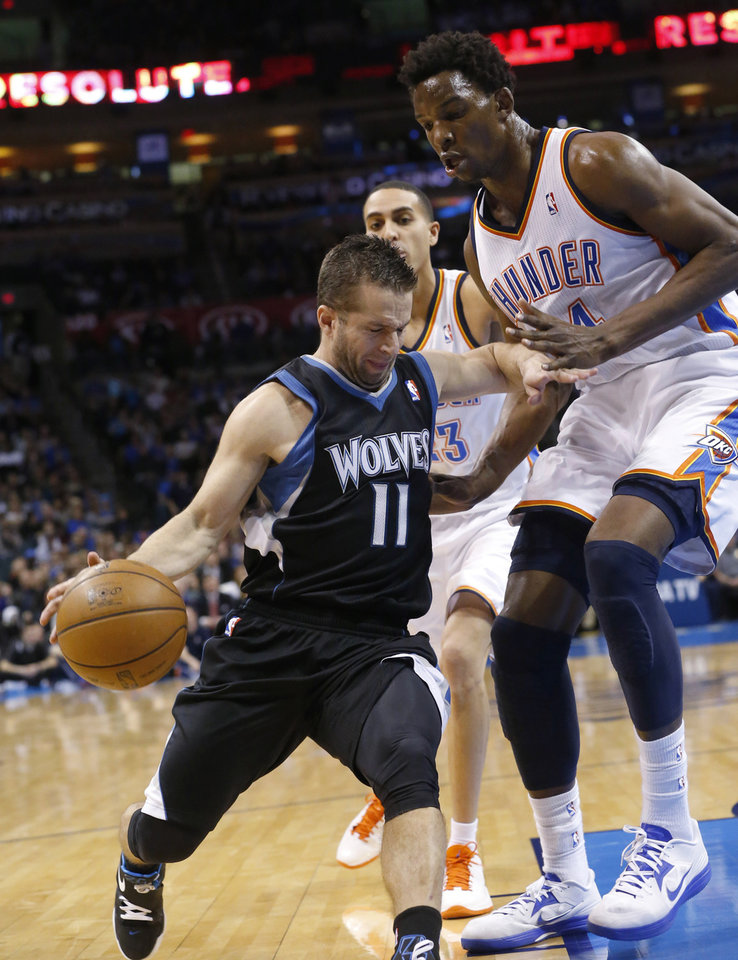 Minnesota Timberwolves guard Jose Barea (11) drives around Oklahoma City Thunder center Hasheem Thabeet (34) during the first quarter of an NBA basketball game in Oklahoma City, Friday, Feb. 22, 2013. (AP Photo/Sue Ogrocki)