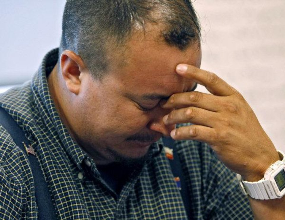 Photo - Byron Rivera, the father of Crystian Rivera, reacts as he talks about his son during a meeting with Staff Writer Tiffany Gibson at The Oklahoman on Wednesday. Crystian Rivera, 13, has been arrested on a murder complaint in connection with the death of his baby half-sister Linda Beletzuy, who was nearly 10 months old when she died of a head injury Friday. Photo by John Clanton, The Oklahoman ORG XMIT: KOD  JOHN CLANTON - John Clanton