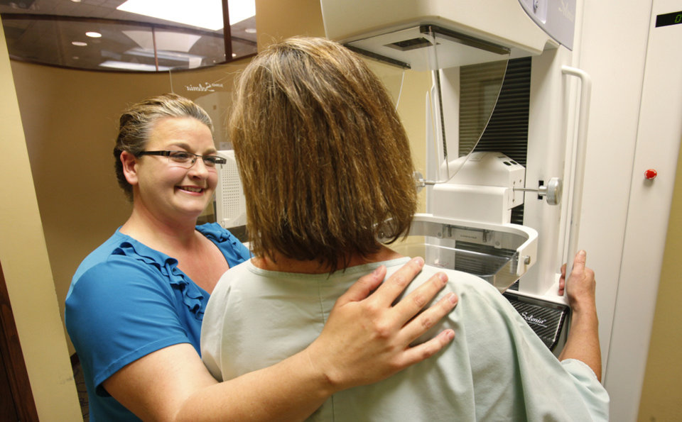 Tracy Cothran talks to a patient Wednesday at the Oklahoma Breast Care Center. Cothran is director of patient care.  Photo By David McDaniel, The Oklahoman