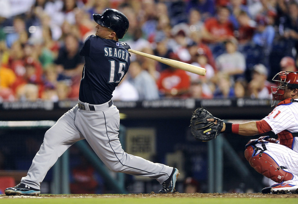 Photo - Seattle Mariners' Kyle Seager hits a solo home run to right field in the sixth inning of an interleague baseball game against the Philadelphia Phillies on Tuesday, Aug. 19, 2014, in Philadelphia. (AP Photo/Michael Perez)