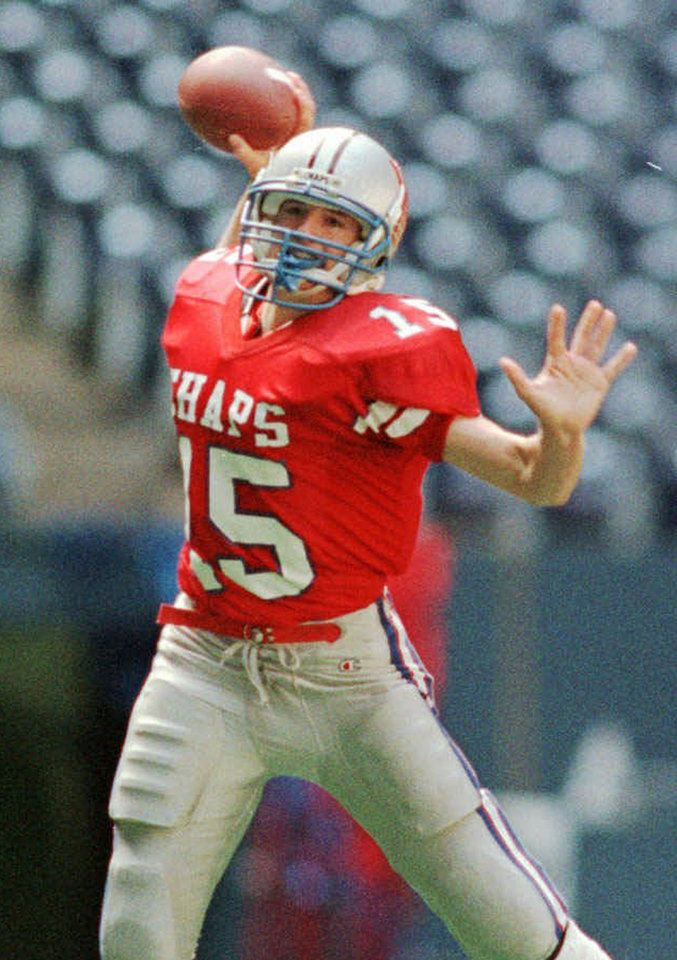Photo - FILE - In this Dec. 21, 1996 file photo, Westlake High School quarterback Drew Brees prepares to pass against Abilene Cooper High School during a football game in Austin, Texas. Ten years after Brees led Westlake High School to victory in the Texas state championship game, Nick Foles broke several of his passing records but lost in the title game. The two quarterbacks meet with far more at stake _ Saints vs. Eagles in an NFC wild-card game. (AP Photo/Austin American Statesman, Ralph Barrera, File) AUSTIN CHRONICLE OUT, COMMUNITY IMPACT OUT, INTERNET MUST CREDIT PHOTOGRAPHER AND STATESMAN.COM