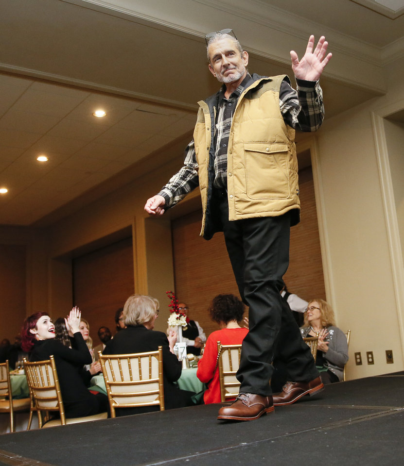 Photo -  Chip Grimmett waves to the crowd as he walk on the runway at the