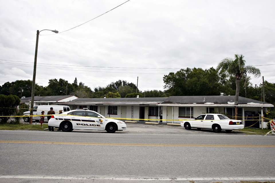 Photo -   Caution tape surrounds the scene of Kenvin's Motel, where Anthony Giancola used a microwave to attack the married couple who own the motel, Friday, June 22, 2012, in Lealman, Fla. Authorities said Giancola, an ex-Tampa Bay-area middle school principal who lost his job over a drug arrest five years ago, went on a rampage Friday, stabbing several people, killing at least two. Authorities said there were 11 victims in all, and several are being treated at area hospitals for injuries ranging from minor to life-threatening. (AP Photo/Tampa Bay Times, Melissa Lyttle) TAMPA OUT; CITRUS COUNTY OUT; PORT CHARLOTTE OUT; BROOKSVILLE HERNANDO TODAY OUT