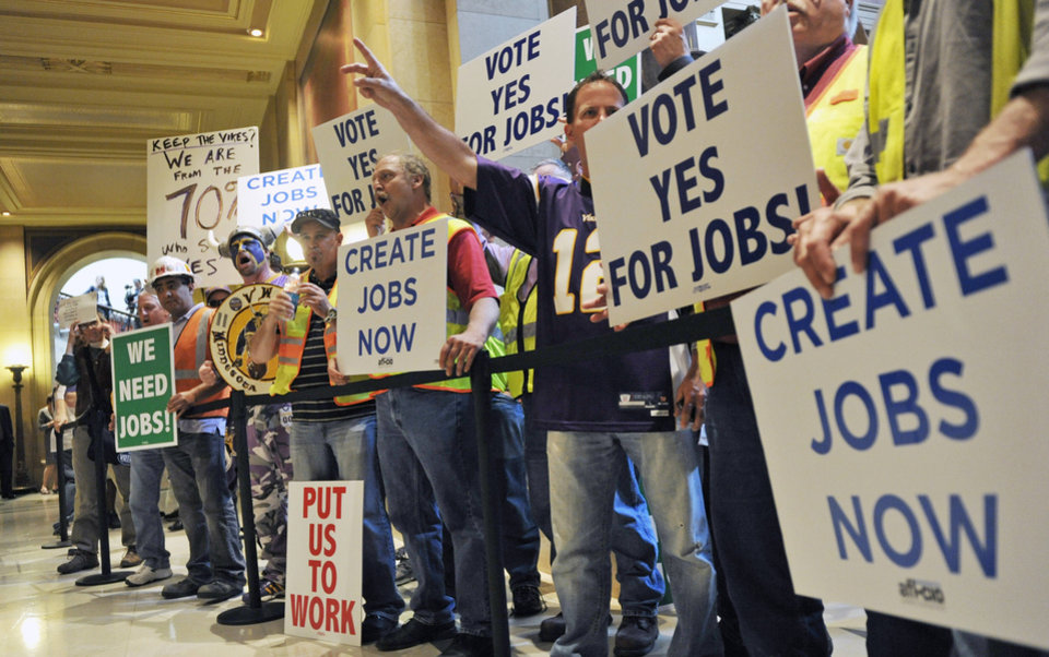 Photo -   Minnesota Vikings supporters and construction trades workers rally outside the Minnesota House as lawmakers were taking up a bill for a new stadium for the Vikings NFL football team Monday, May 7, 2012, in St. Paul, Minn. (AP Photo/Jim Mone)