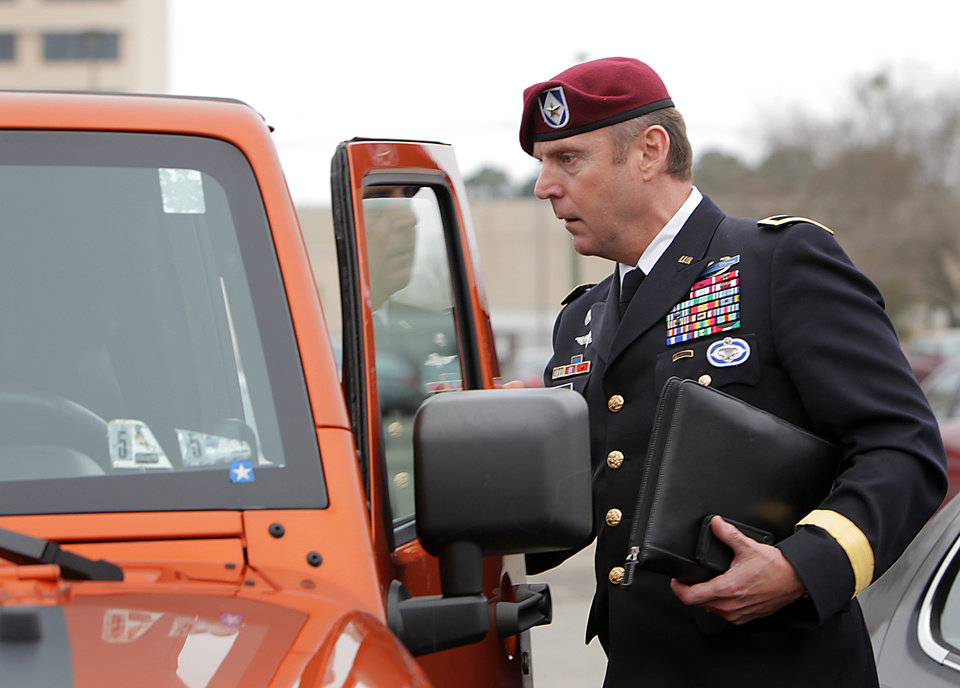 Photo - Brig. Gen. Jeffrey Sinclair, who faces charges related to having inappropriate relationships with subordinates, leaves court at Fort Bragg in Fayetteville, N.C., Wednesday, March 19, 2014. Closing arguments were presented, but no sentence was reached. (AP Photo/Ted Richardson)