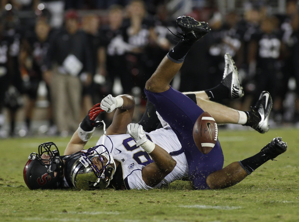 Photo - Stanford's Trent Murphy, back, breaks up a pass to Washington's Austin Seferian-Jenkins during the second half of an NCAA college football game in Stanford, Calif., Saturday, Oct. 5, 2013. (AP Photo/George Nikitin)