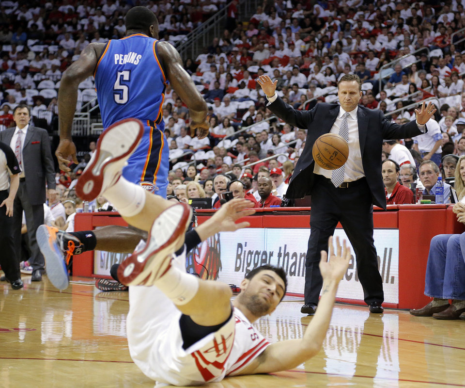 Oklahoma City head coach Soctt Brooks reacts to a play between Oklahoma City\'s Kendrick Perkins (5) and Houston\'s Carlos Delfino (10) during Game 3 in the first round of the NBA playoffs between the Oklahoma City Thunder and the Houston Rockets at the Toyota Center in Houston, Texas, Sat., April 27, 2013. Photo by Bryan Terry, The Oklahoman