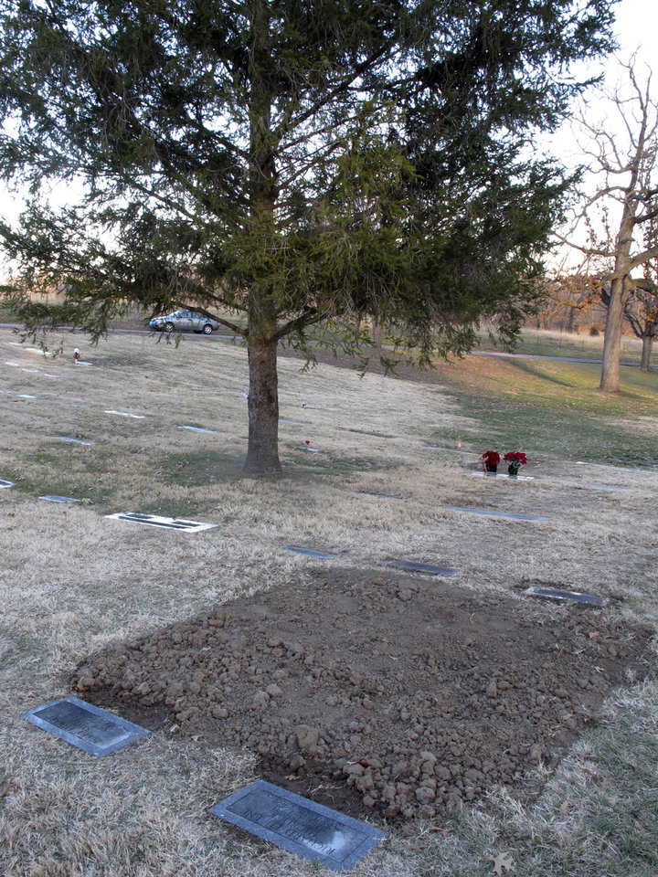 The graves of convicted and executed murderers Richard Hickock, left, and Perry Smith, right, sit side by side in Mount Muncie Cemetery after the exhumation and reburial of their remains, Tuesday, Dec. 18, 2012, in Lansing, Kan. Their killings of a family in 1959 inspired Truman Capoteís book, ìIn Cold Blood,î and Florida authorities believe they may be tied to decades-old killings there. (AP Photo/John Hanna)
