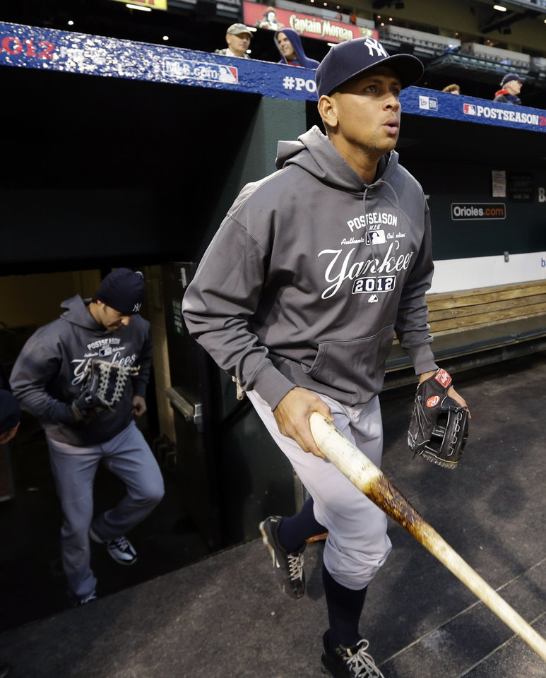 New York Yankees' Alex Rodriguez walks onto the field before Game 2 of the American League division baseball series against the Baltimore Orioles, Monday, Oct. 8, 2012, in Baltimore. (AP Photo/Patrick Semansky)