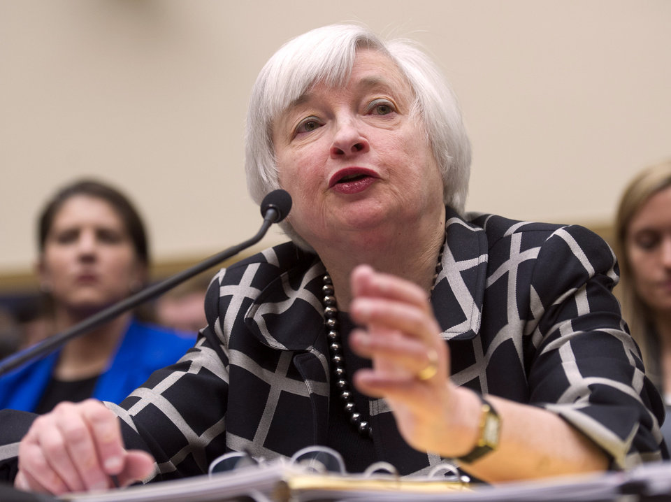 Photo - Federal Reserve Chair Janet Yellen testifies on Capitol Hill in Washington, Tuesday, Feb. 11, 2014, before the House Financial Services Committee hearing. Yellen said Tuesday that if the economy keeps improving, the Fed will take