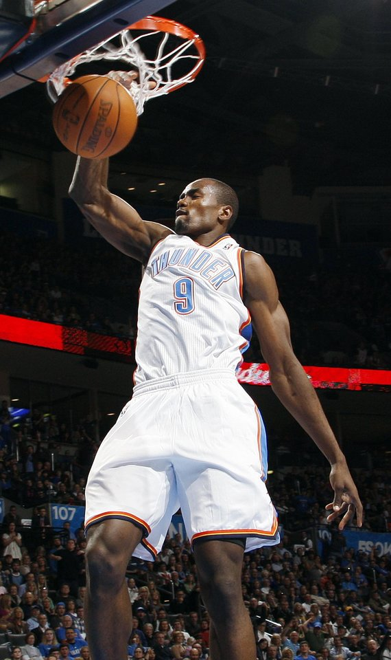 Photo - Oklahoma City's Serge Ibaka dunks the ball in the first half during an NBA basketball game between the Oklahoma City Thunder and the Dallas Mavericks at Chesapeake Energy Arena in Oklahoma City, Thursday, Dec. 29, 2011. Photo by Nate Billings, The Oklahoman