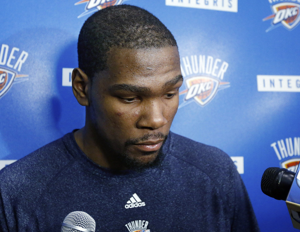 Oklahoma City Thunder forward Kevin Durant listens to a question Friday during a news conference. All-Star point guard Russell Westbrook will have surgery  and be out indefinitely. AP Photo