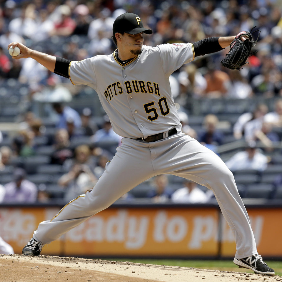 Photo - Pittsburgh Pirates starting pitcher Charlie Morton throws during the first inning of the first baseball game of a double-header against the New York Yankees at Yankee Stadium, Sunday, May 18, 2014 in New York. (AP Photo/Seth Wenig)