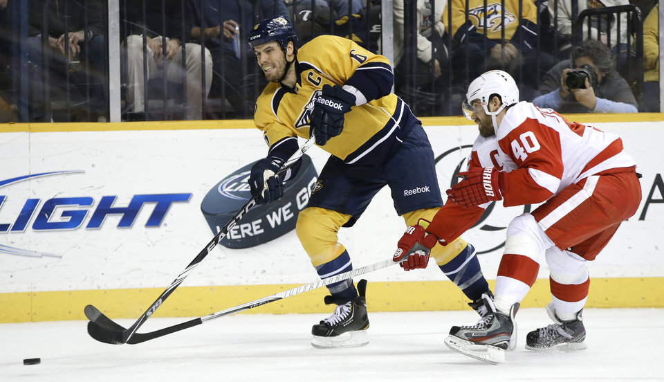 Nashville Predators defenseman Shea Weber (6) passes the puck ahead of Detroit Red Wings center Henrik Zetterberg (40), of Sweden, during the second period of an NHL hockey game Tuesday, Feb. 19, 2013, in Nashville, Tenn. (AP Photo/Mark Humphrey)