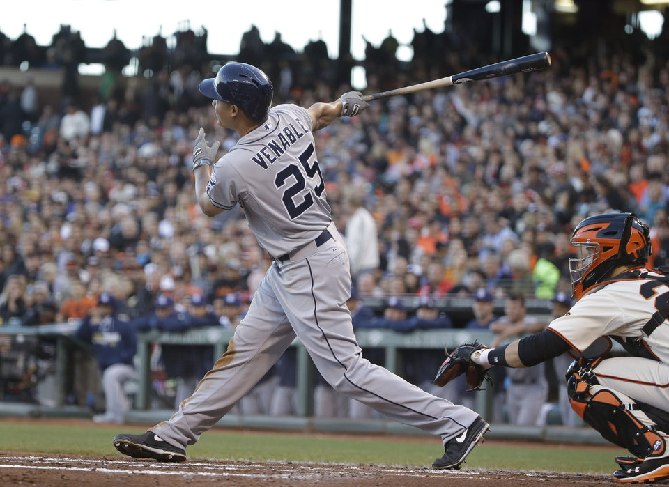 Photo - San Diego Padres' Will Venable hits a sacrifice fly off San Francisco Giants starting pitcher Tim Hudson in the third inning of their baseball game, Tuesday, June 24, 2014, in San Francisco. The Padres' Will Venable scored from third base on the play. (AP Photo/Eric Risberg)