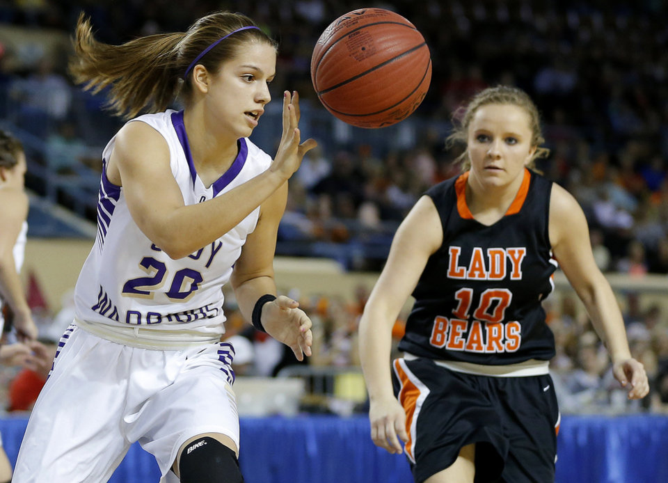 Okarche's Morgan Vogt comes down with the ball beside Cheyenne's Lauren Wright during the Class A girls state championship game between Okarche and Cheyenne/Reydon in the State Fair Arena at State Fair Park in Oklahoma City, Saturday, March 2, 2013. Photo by Bryan Terry, The Oklahoman