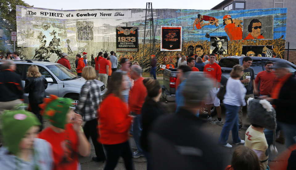 People walk past the Phi Kappa Tau/Delta Delta Delta house decoration during Walkaround at Oklahoma State University\'s homecoming in Stillwater, Okla., Friday, Oct. 19, 2012. Photo by Nate Billings, The Oklahoman