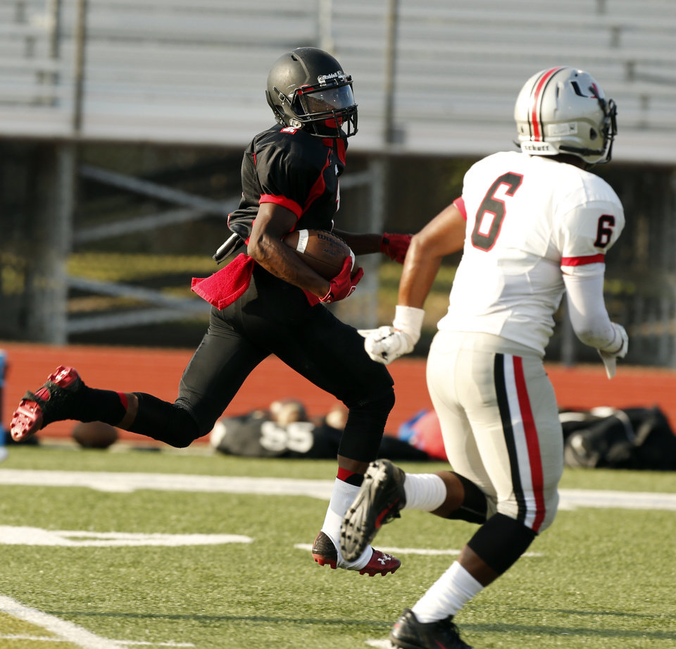 Photo - Westmoore's Stephan Robinson scores on a pass during at high school football scrimmage against Tulsa Union at Harve Collins Field in Norman, Okla., on Thursday, Aug. 21, 2014. Photo by Steve Sisney, The Oklahoman
