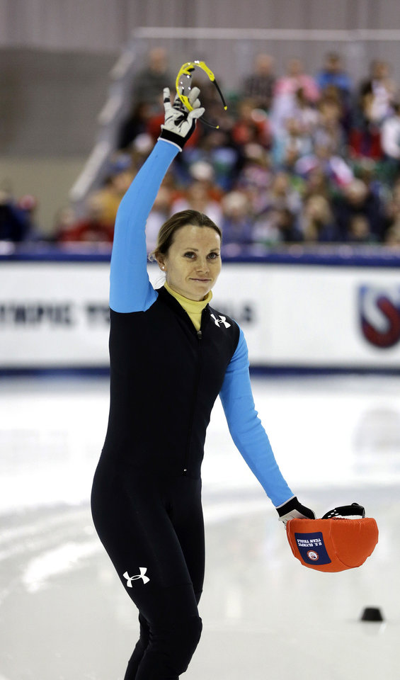 Photo - Jessica Smith reacts to the crowd before her race in the women's 1,500 meters during the U.S. Olympic short track speedskating trials, Friday, Jan. 3, 2014, in Kearns, Utah. (AP Photo/Rick Bowmer)