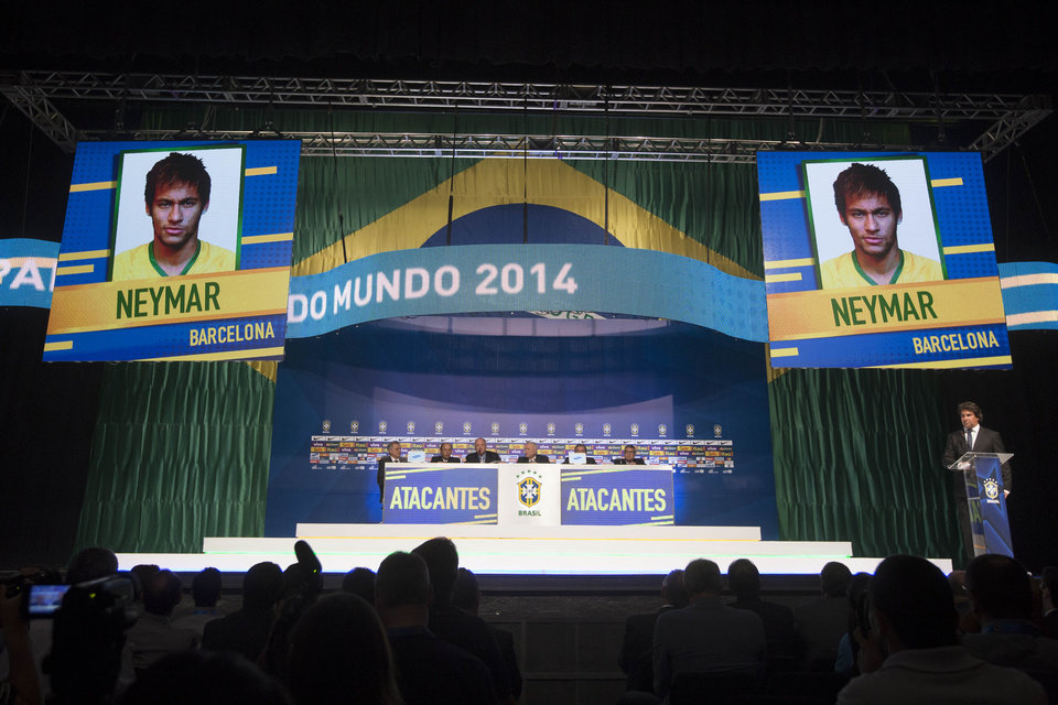 Photo - Brazil's soccer coach Luiz Felipe Scolari announces his list of players for the 2014 Soccer World Cup during a news conference in Rio de Janeiro, Brazil, Wednesday, May 7, 2014. A photo of Neymar is seen on two screens as he is announced. (AP Photo/Felipe Dana)