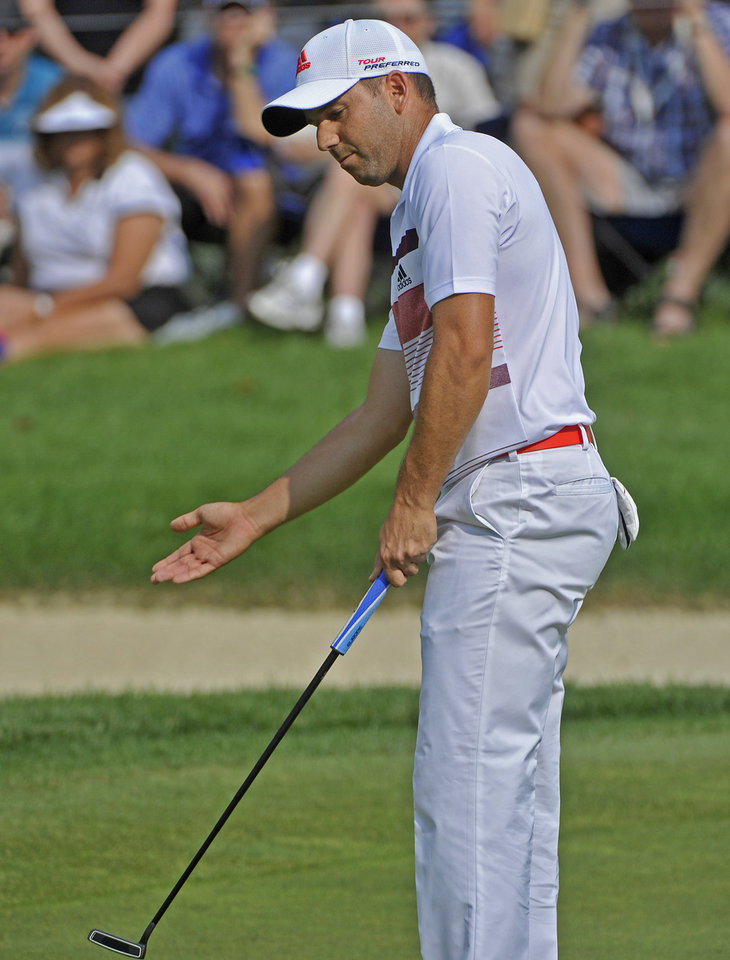 Photo - Sergio Garcia of Spain watches his putt on the third hole, during the third round of the Bridgestone Invitational golf tournament, Saturday Aug. 2, 2014, in Akron, Ohio. (AP Photo/Phil Long)