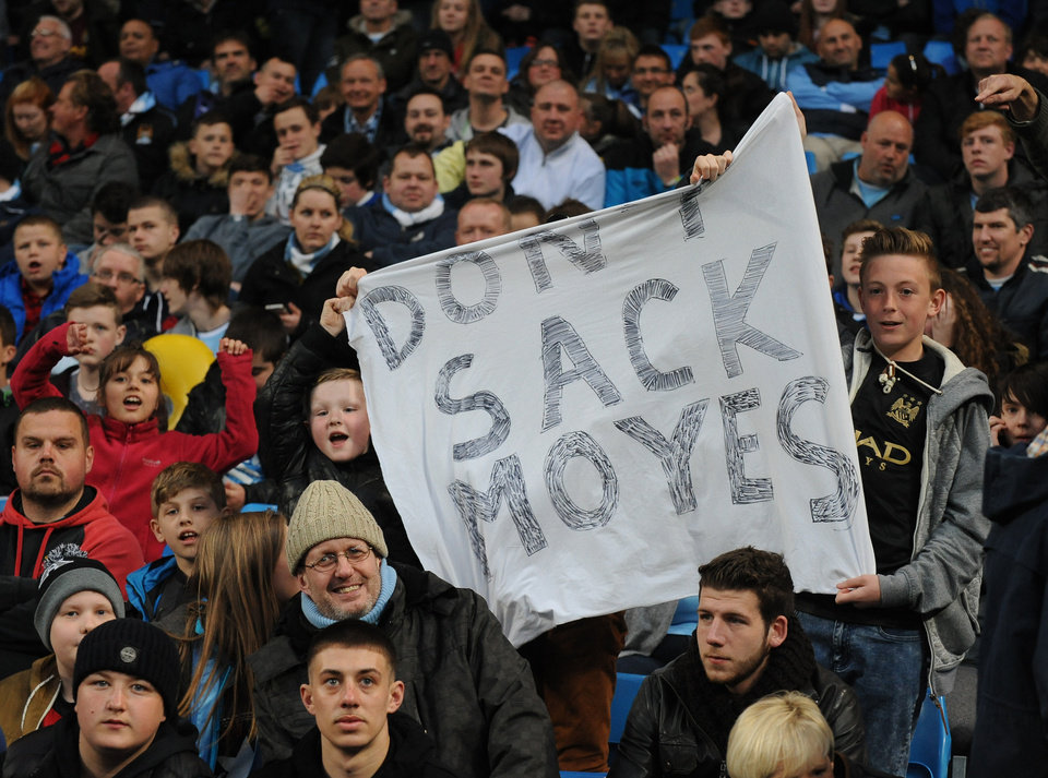 Photo - Manchester City supporters display a banner with reference to Manchester United manager David Moyes, during the English Premier League soccer match between Manchester City and West Bromwich at the Etihad Stadium,  Manchester, England, Monday, April  21, 2014. (AP Photo/Rui Vieira)