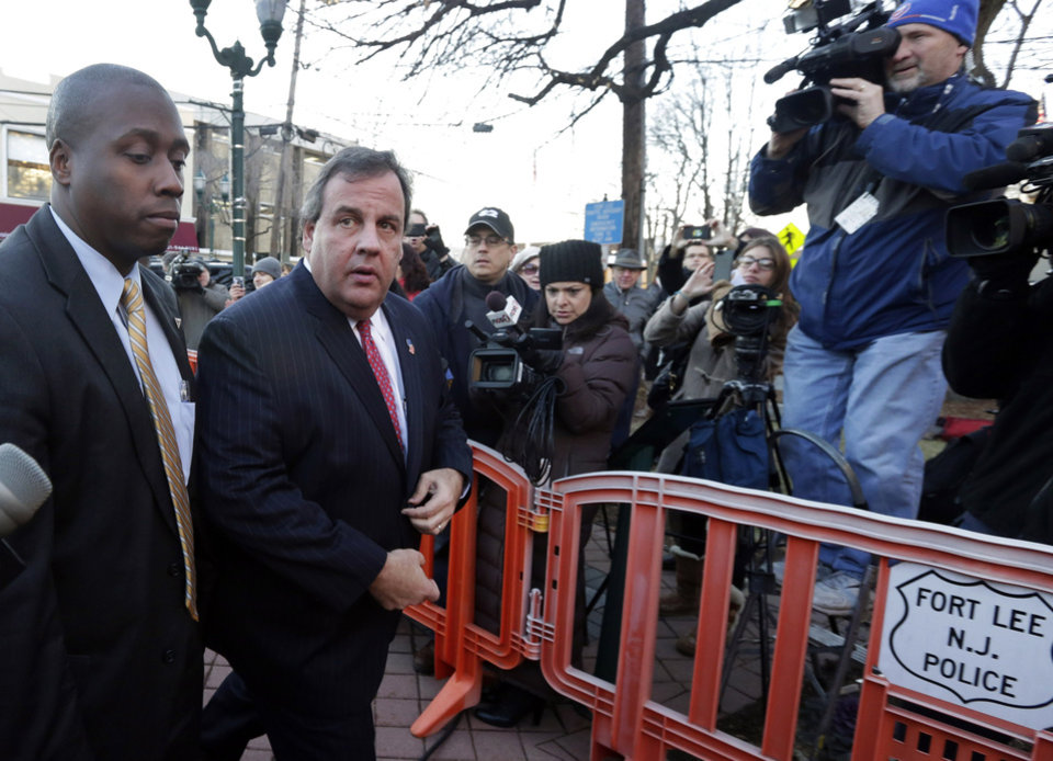 Photo - New Jersey Gov. Chris Christie, second left, arrives at Fort Lee, N.J., City Hall,  Thursday, Jan. 9, 2014. Christie traveled to Fort Lee to apologize in person to Mayor Mark Sokolich. Moving quickly to contain a widening political scandal, Gov. Chris Christie fired one of his top aides Thursday and apologized repeatedly for the