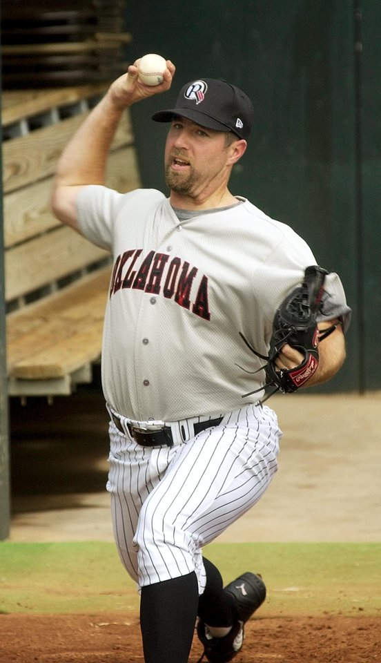 Oklahoma City - June 20, 2003.    MINOR LEAGUE BASEBALL: R.A. Dickey pitches in the Oklahoma RedHawks bullpen after reporting to the baseball team. Dickey was recently sent down from the Texas Rangers. Staff photo by Nate Billings.