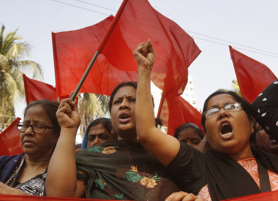Bangladeshi garment workers shout slogans as they participate in a protest to mourn the death of the victims of a fire in a garment factory in Dhaka, Bangladesh, Friday, Nov. 30, 2012. Hundreds of garment workers protested Friday outside the Bangladeshi factory where 112 people were killed by the fire, demanding compensation for their lost salaries. (AP Photo/Pavel Rahman)