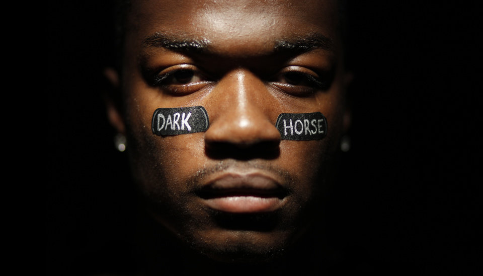"Tre Porter, of Carl Albert, for the cover of the high school football playoff special section themed, ""Dark Horse"" at OPUBCO studio Saturday, Nov. 7, 2009. Photo by Doug Hoke, The Oklahoman"