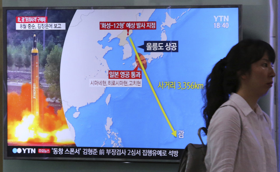 "Photo - A woman passes by a TV screen showing a local news program reporting on North Korea's threats to strike Guam with missiles at the Seoul Train Station in Seoul, South Korea, Thursday, Aug. 10, 2017. North Korea has announced a detailed plan to launch a salvo of ballistic missiles toward the U.S. Pacific territory of Guam, a major military hub and home to U.S. bombers. If carried out, it would be the North's most provocative missile launch to date. The signs at left top read "" North Korea announced a plan to launch a salvo of ballistic missiles toward the Guam. (AP Photo/Ahn Young-Joon)"