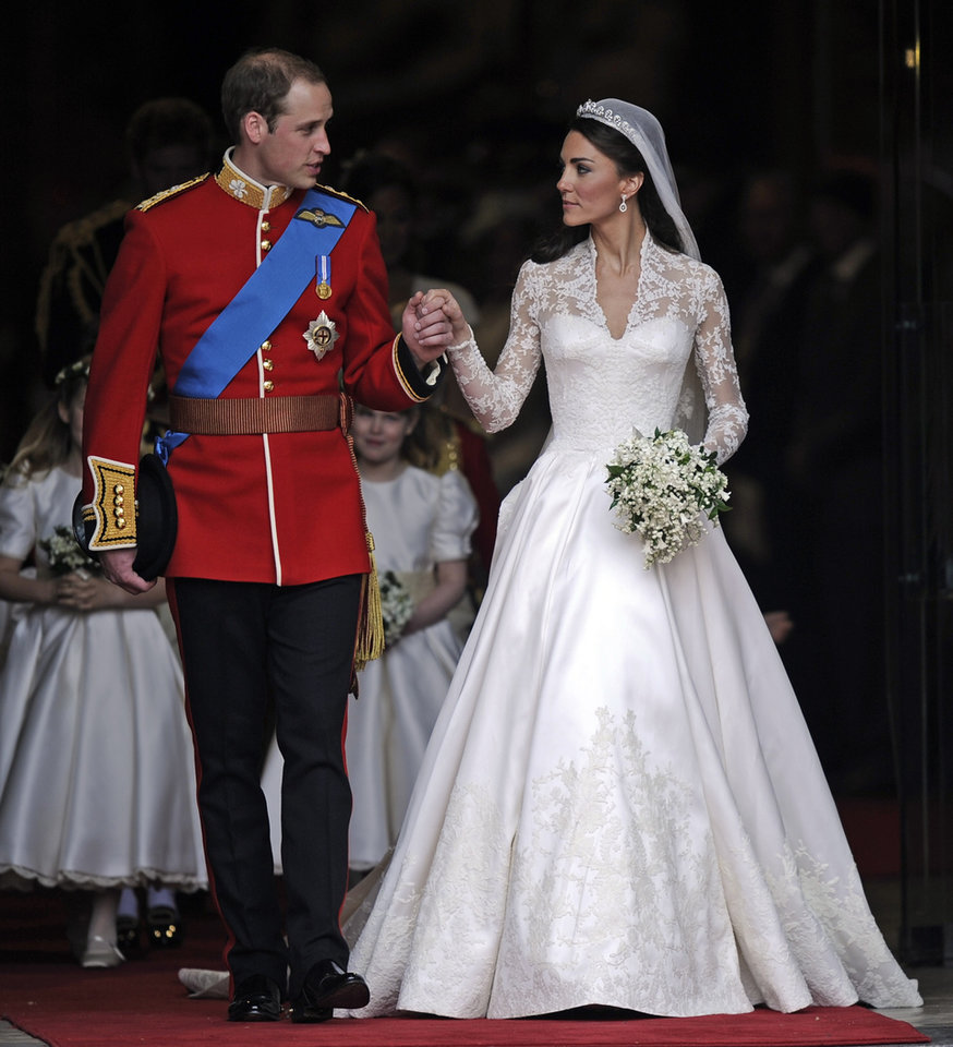 Photo - Britain's Prince William and his wife Kate, Duchess of Cambridge stand outside of Westminster Abbey after their Royal Wedding in London Friday, April, 29, 2011. (AP Photo/Martin Meissner) ORG XMIT: RWMG143