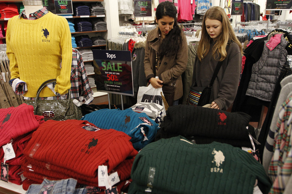 Photo - Ophelie Ponnelle and Rizlene El Yazioi shop at the Polo outlet during Black Friday at The Outlet Shoppes at Oklahoma City, Thursday, Nov. 24, 2011.  Photo by Garett Fisbeck, For The Oklahoman