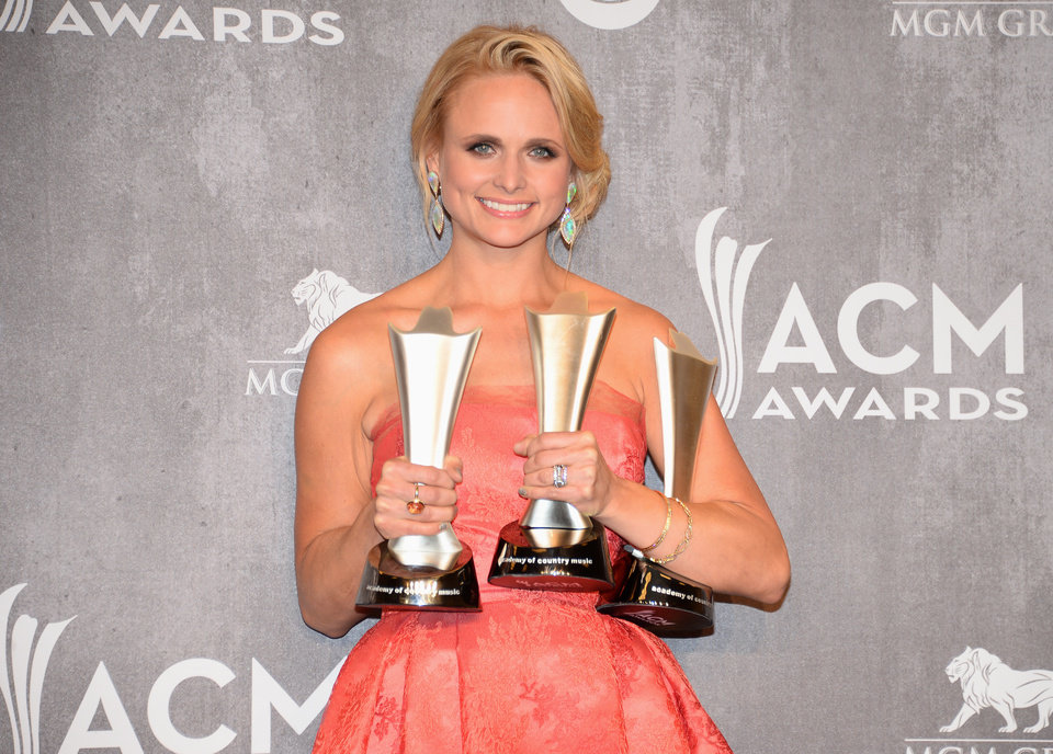 Photo - Miranda Lambert poses in the press room with the awards for vocal event of the year, female vocalist of the year and single record of the year at the 49th annual Academy of Country Music Awards at the MGM Grand Garden Arena on Sunday, April 6, 2014, in Las Vegas. (Photo by Al Powers/Powers Imagery/Invision/AP)