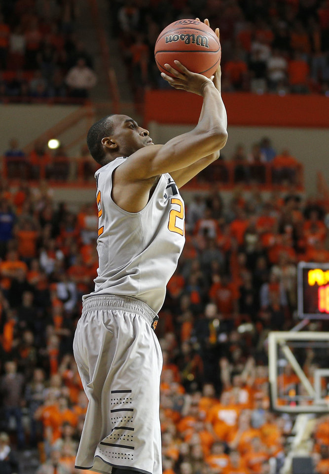 Photo - Oklahoma State's Markel Brown (22) shoots a basket during an NCAA college basketball game between Oklahoma State University (OSU) and the University of Kansas at Gallagher-Iba Arena in Stillwater, Okla., Saturday, March 1, 2014. Oklahoma State won 72-65. Photo by Bryan Terry, The Oklahoman