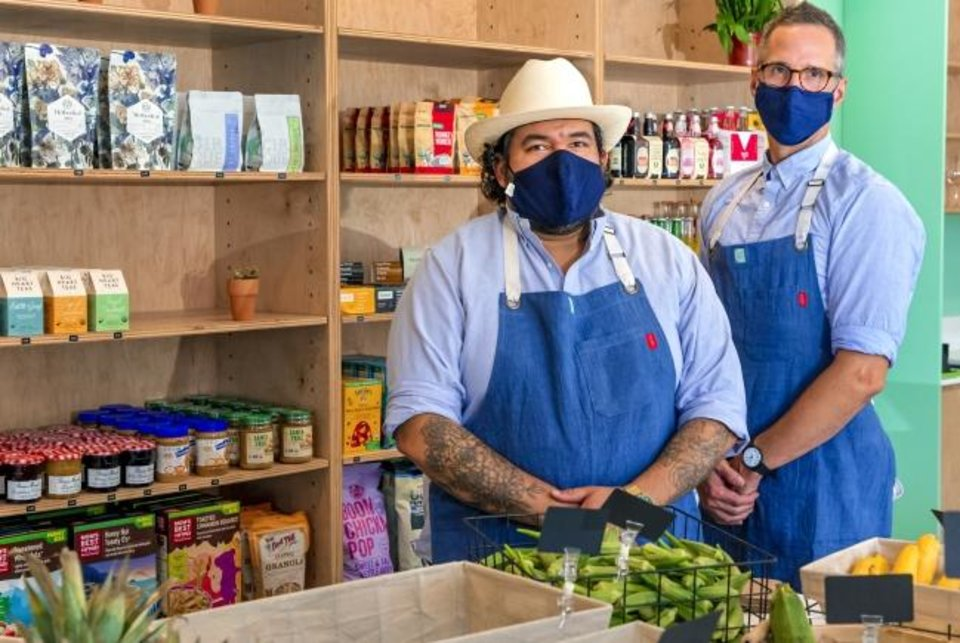 Photo -  Chris Castro and Eric Berumen, from left, opened The Market at Commonplace  on Thursday.  [CHRIS LANDSBERGER/THE OKLAHOMAN]