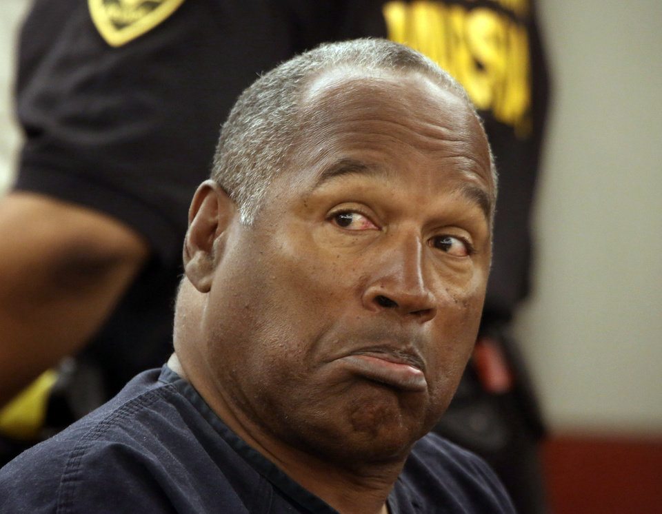 Photo - O.J. Simpson appears at Clark County Regional Justice Center,  Monday, May 13, 2013. Simpson, 65,  former Hall of Fame football player and celebrity, is requesting a retrial from the 2008 Las Vegas trial that sent him to Nevada prison for ahotel room robbery. (AP Photo/Las Vegas Review-Journal, Jeff Scheid, Pool)