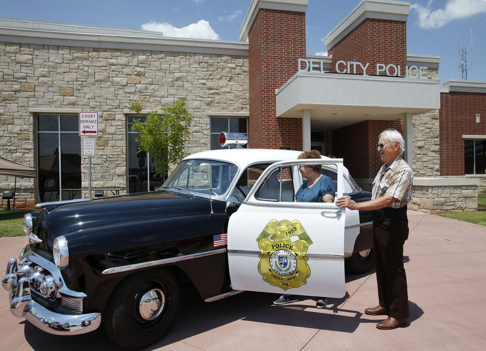 Photo - The new police station in Del City was officially dedicated Thursday afternoon. Bill and Edith Giles look at a 1953 Chevrolet police cruiser parked in front on the new station for the dedication ceremony. Photo by Jim Beckel, THE OKLAHOMAN