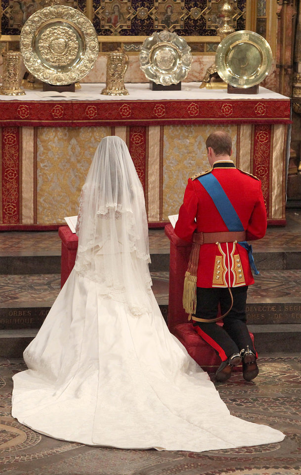 Photo - Kate Middleton and Britain's Prince William kneel at the altar during their wedding service at Westminster Abbey, London, Friday April 29, 2011. (AP Photo/Dominic Lipinski, Pool)  ORG XMIT: RWDJ115