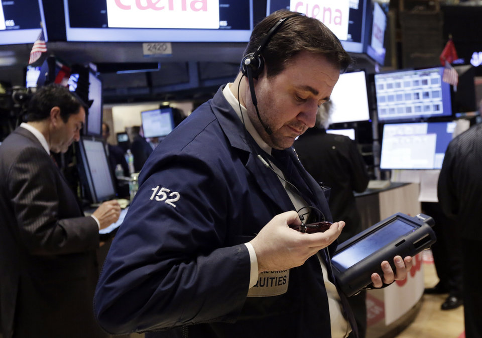 Photo - Traders work on the floor of the New York Stock Exchange, Thursday, April 3, 2014. Stocks indexes are edging higher as investors become more optimistic about the outlook for the U.S. economy. (AP Photo/Richard Drew)