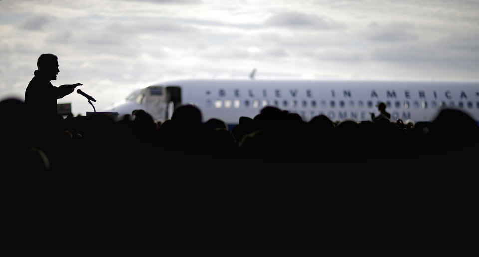 Republican presidential candidate, former Massachusetts Gov. Mitt Romney, left, speaks at a campaign event at Dubuque Regional Airport, before flying to Colorado, Saturday, Nov. 3, 2012, in Dubuque, Iowa. (AP Photo/David Goldman)