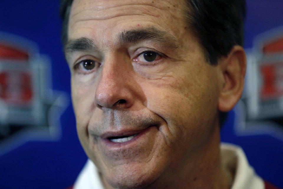 Photo - Alabama head coach Nick Saban talks to reporters after practice for the Jan. 2 Sugar Bowl NCAA college football game against Oklahoma, in New Orleans on Saturday, Dec. 28, 2013. (AP Photo/Gerald Herbert)